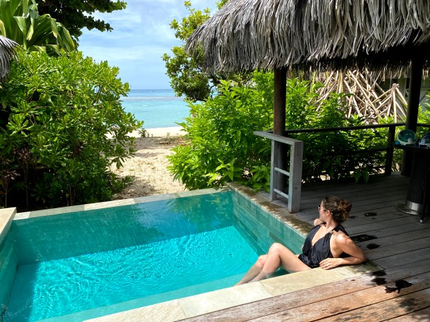 Woman lounging in private pool in French Polynesia