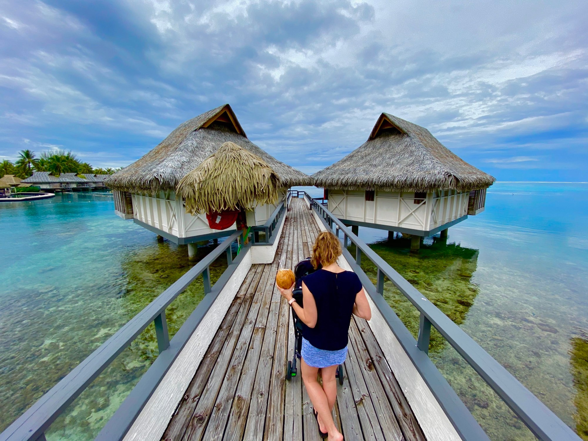 Walking out to an overwater bungalow in Moorea, French Polynesia