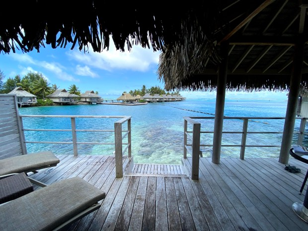 Overwater bungalow with turquoise ocean in Moorea, French Polynesia