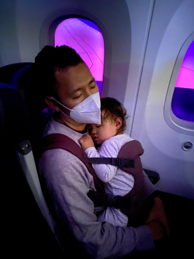 Sleeping with a baby in a carrier on an airplane