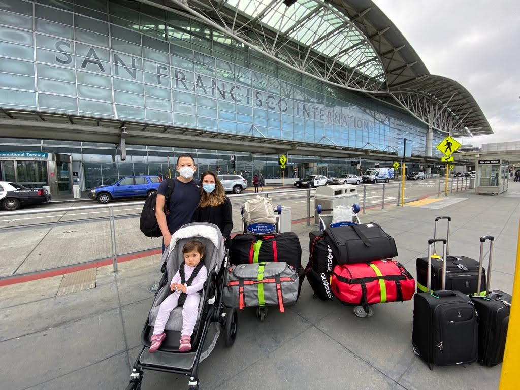 Family with luggage outside SFO airport